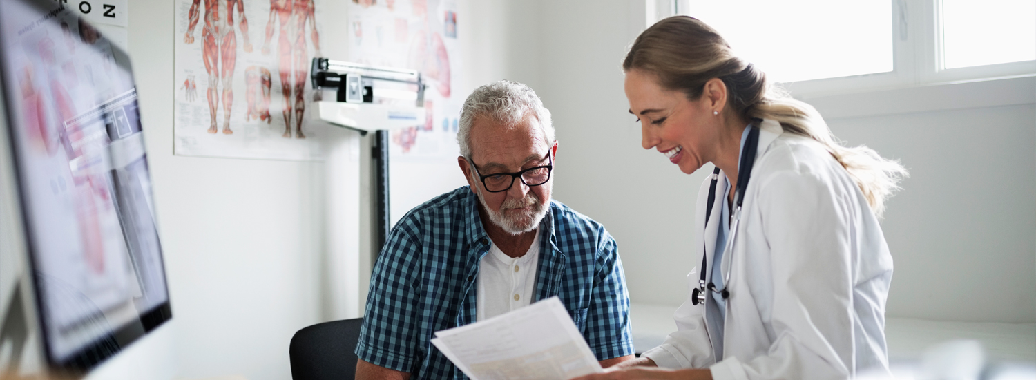 Patient with Doctor looking at Documents